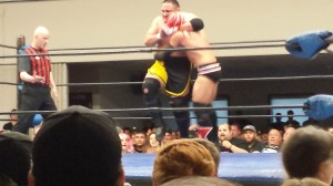 Samoa Joe practices the patented NXT headlock on Michael Richard Blais.